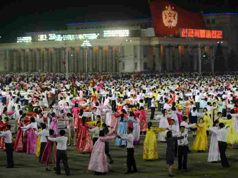 North Koreans in Pyongyang rehearse for the commemoration of the 100th anniversary of Kim Il Sung's birth on April 15.