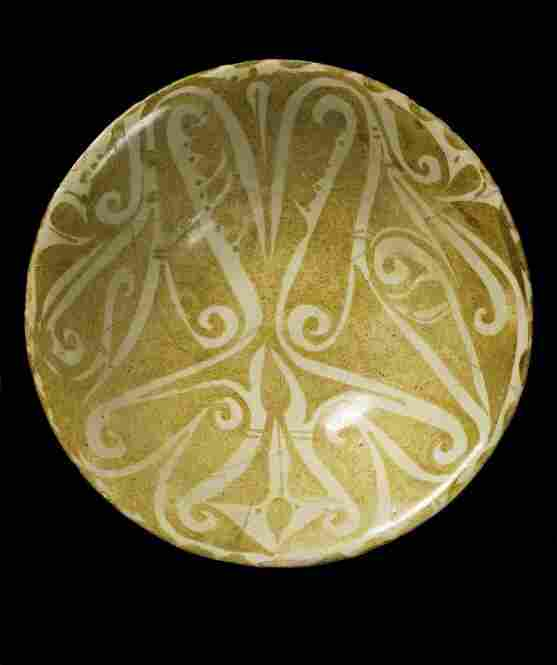 "Earthenware bowl from Iraq, ninth or 10th century. The world ""blessing"" is inscribed in Arabic."
