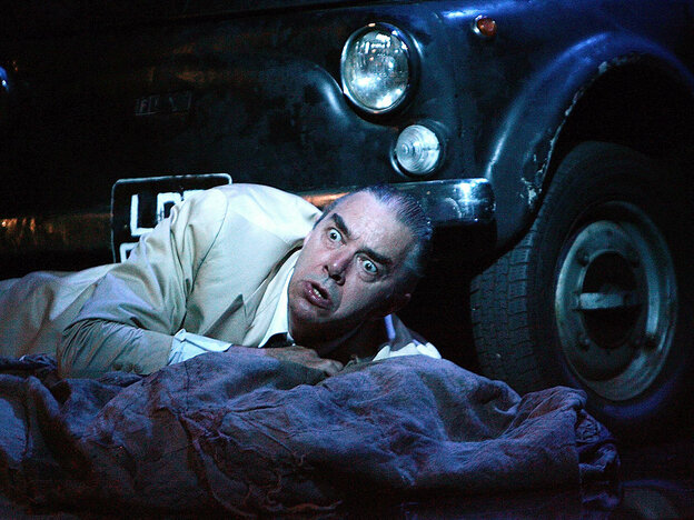 In a production of Verdi's opera Rigoletto at the Sydney Opera House, the title character (baritone Jonathan Summers) reels at the discovery of his dead daughter.