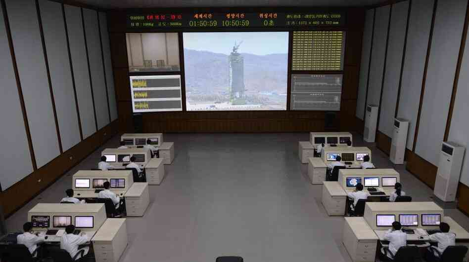 North Korea technicians watch live images of the rocket fueling at the satellite control room of the space center near Pyongyang.