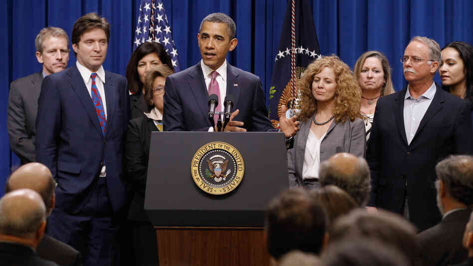 "President Obama, with millionaires and their assistants, makes a point on the ""Buffett Rule"" in Washington, DC, Wednesday, April 11, 2012."