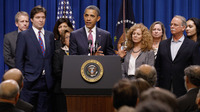 President Obama, with millionaires and their assistants, makes a point on the