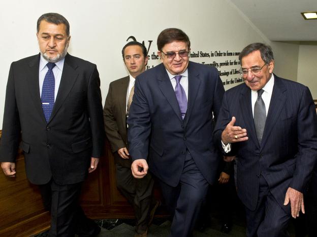 Secretary of Defense Leon E. Panetta, far right, escorts Afghanistan's Minister of National Defense Abdul Rahim Wardak (center) and Minister of Interior Gen. Bismillah Khan Mohammadi (left) in the Pentagon.