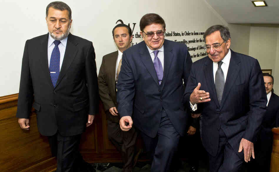 Secretary of Defense Leon E. Panetta, far right, escorts Afghanistan's Minister of National Defense Abdul Rahim Wardak (center) and Minister of I
