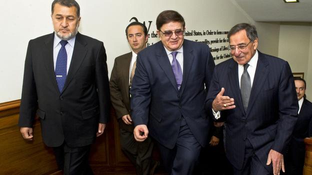Secretary of Defense Leon E. Panetta, far right, escorts Afghanistan's Minister of National Defense Abdul Rahim Wardak (center) and Minister of Interior Gen. Bismillah Khan Mohammadi (left) in the Pentagon. (OASD/PA)