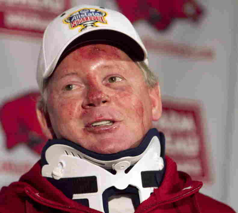 Dismissed Arkansas football coach Bobby Petrino at an April 3 news conference, following his release from a hospital where he was treated for injuries suffered in a motorcycle accident. That mishap led to the revealing of his affair with a younger woman, payments he made to her and that he had arranged for her to get a job at the university.