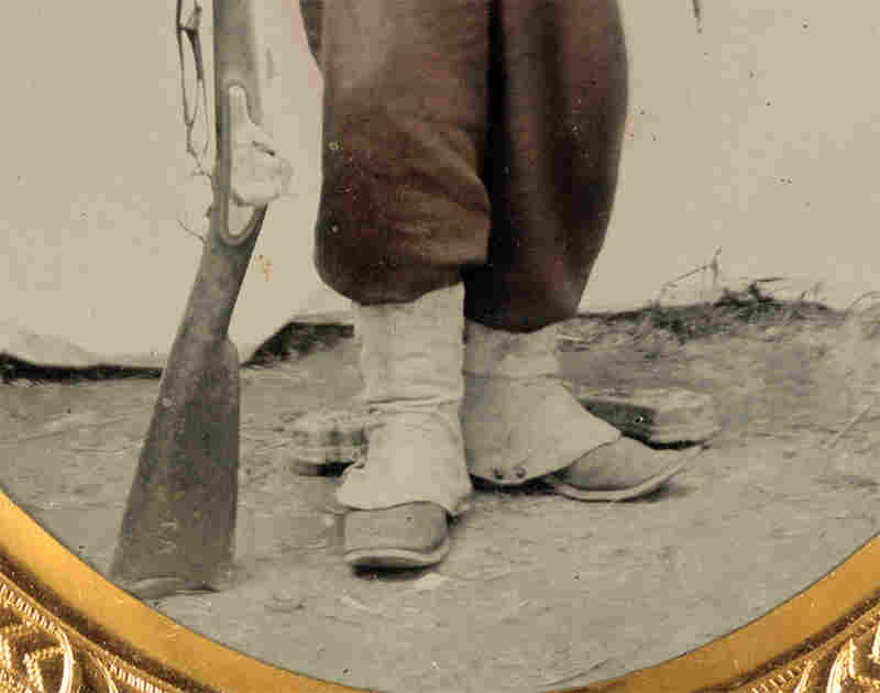 "Zooming in on the image reveals that the stock of the soldier's rifle musket has two letters etched into it: ""T.A."""