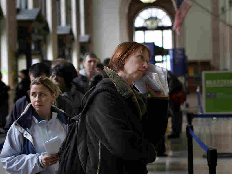 People wait in line inside the Farley Post Office building on Tax Day 2009 in New York City.