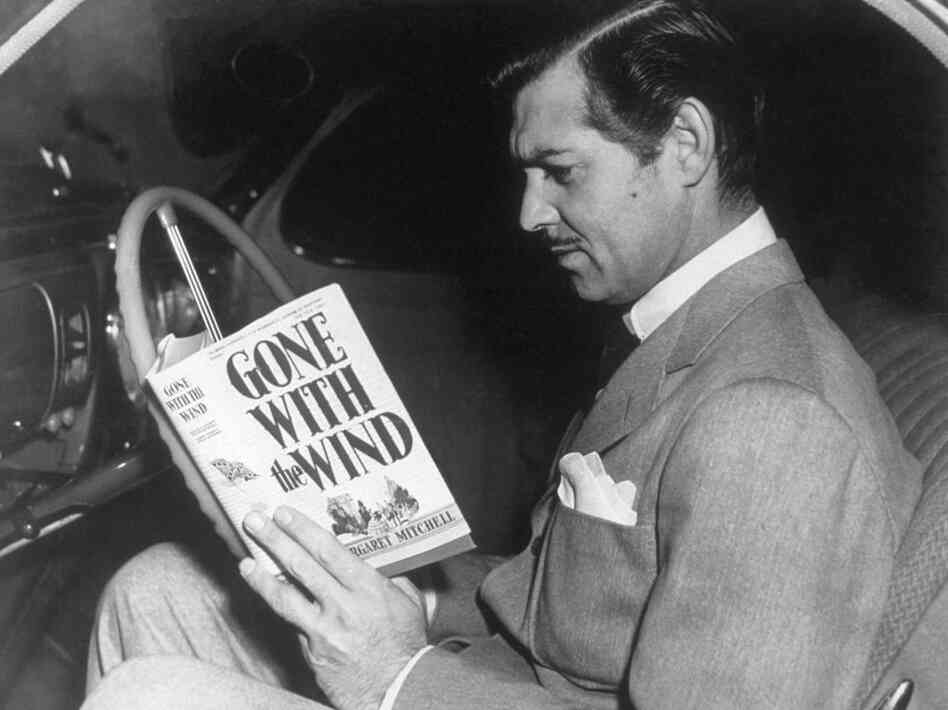 Margaret Mitchell's Gone with the Wind was at the center of Depression-era price-fixing controversies. Here, Clark Gable prepares for his role as Rhett Butler in the MGM film adaptation.