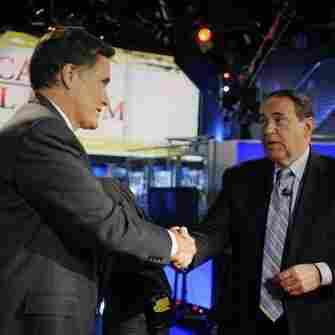 Running mates? Mitt Romney greets former Gov. Mike Huckabee after taking part in a Republican presidential forum on Huckabee's Fox News program on Dec. 3, 2011.