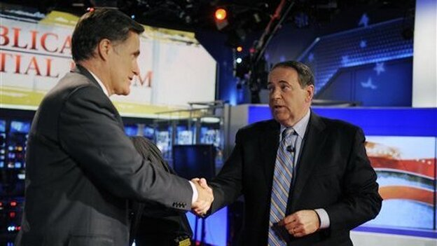 Running mates? Mitt Romney greets former Gov. Mike Huckabee after taking part in a Republican presidential forum on Huckabee's Fox News program on Dec. 3, 2011.
