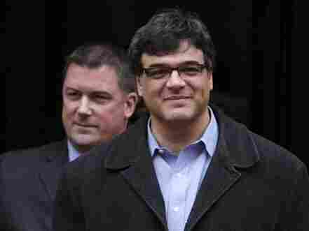 Former CIA officer John Kiriakou (right), accompanied by his attorney, John Hundley, leaves federal court in Alexandria, Va., on Jan. 23. Kiriakou, who helped track down and capture a top terrorism suspect, was charged with disclosing classified secrets about his teammates to the media.