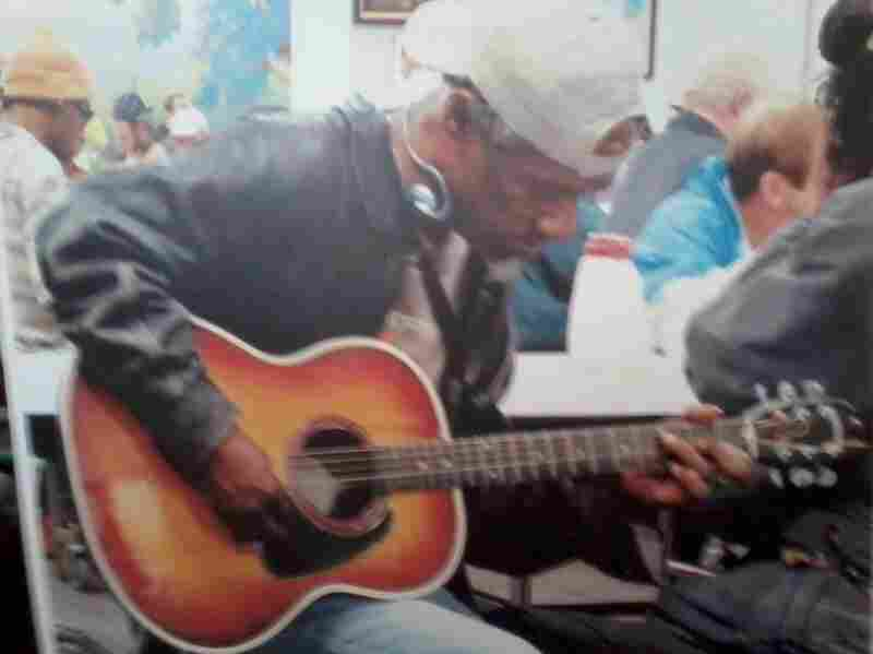 In his family's only photo of him, Bobby Clark plays guitar at the homeless shelter he frequented. Clark often played for shelter patrons and staff.