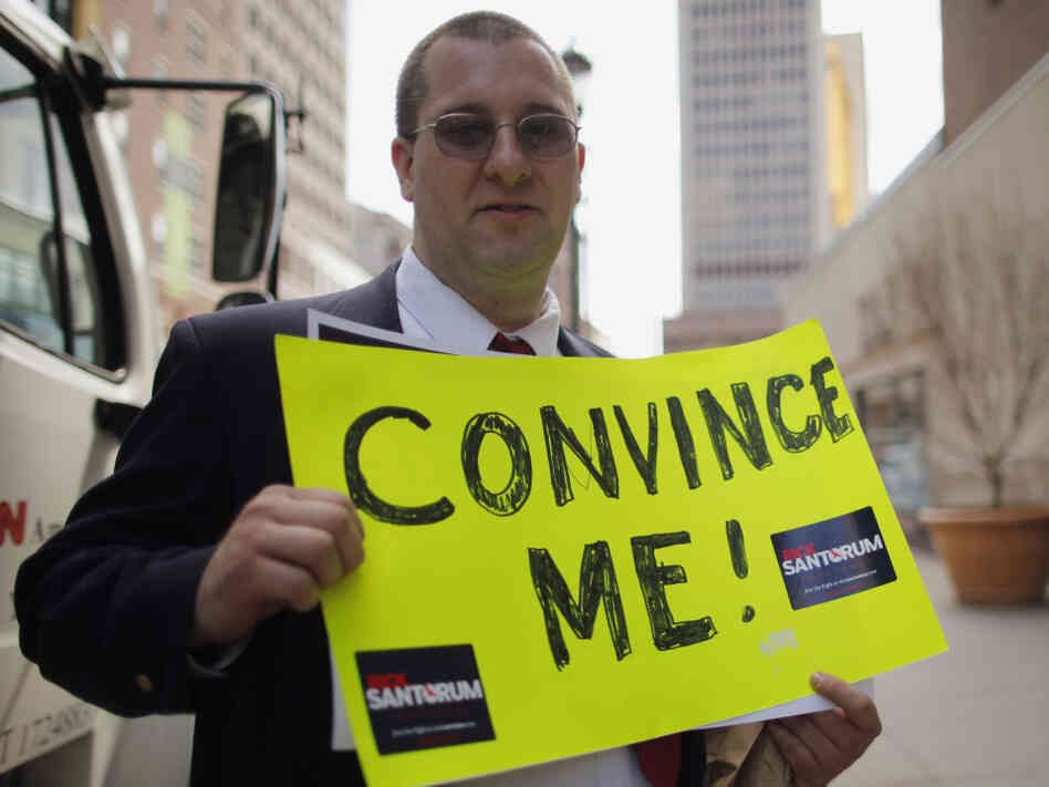 "Presumptive GOP nominee Mitt Romney still has some work to do with conservative voters. Chris O'Brien, state grass-roots organizer for former Republican presidential candidate Rick Santorum, holds a sign reading ""Convince Me!"" outside a Romney campaign stop in Hartford, Conn., on April 11."