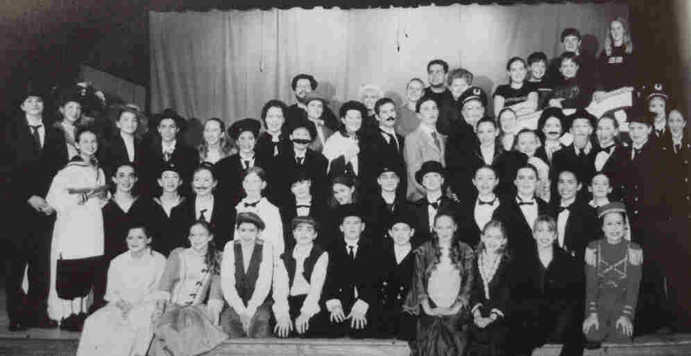 "The cast and crew of Titanic, as pictured in my 2001-2002 yearbook. I'm standing in the third row back on the right side, in front of the ""captain."""