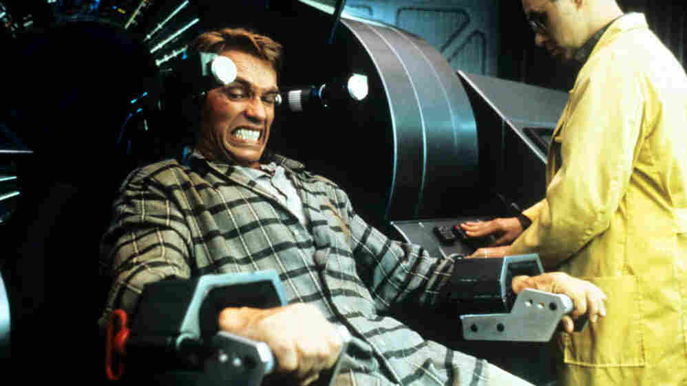 Who Will You Be In 2080? In Paul Verhoeven's movie Total Recall, set in 2084, some people are able to control — and reprogram — other people's memories, to the point that Arnold Schwarzenegger's character does not know exactly who he is. Or whether he is really on Earth or Mars.
