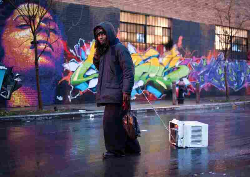 """Homeless since being released from jail ... [Prince] spends the night collecting scrap metal and old pallets that he cashes in before sunrise. He uses the money mostly for heroin, an addiction that has landed him in prison three times. From the Virgin Islands but raised in the Bronx, he is the oldest of 17 children. He was molested by a neighbor as a child, something he is only now understandi..."