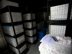 Thousands of doses of cholera vaccine sit in a refrigerated trailer in a United Nations compound in Saint-Marc, Haiti.