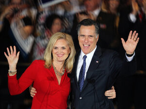 Republican presidential candidate Mitt Romney and his wife Ann Romney greet supporters during an Illinois GOP primary victory party March 20, 2012 in Schaumburg, Illinois.