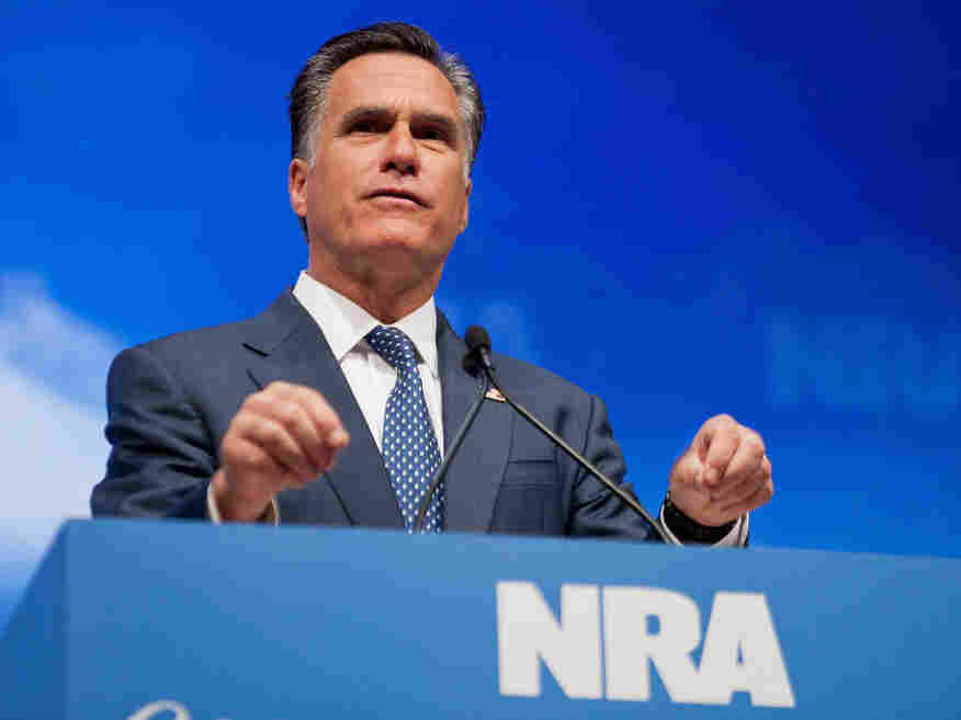Mitt Romney speaks to the National Rifle Association convention Friday in St. Louis.
