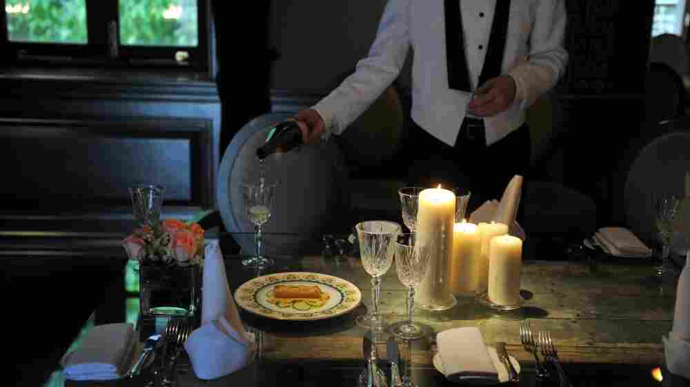 A waiter pours wine at a recreation of the Titanic's last meal at the Hullett House hotel in Hong Kong.