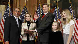 House Speaker John Boehner administers the House oath to Rep. Jason Altmire, D-Pa., on Jan. 5, 2011.