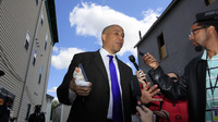 Newark Mayor Cory Booker said he did what anyone would do in rescuing a neighbor Thursday night from a fire at her home.