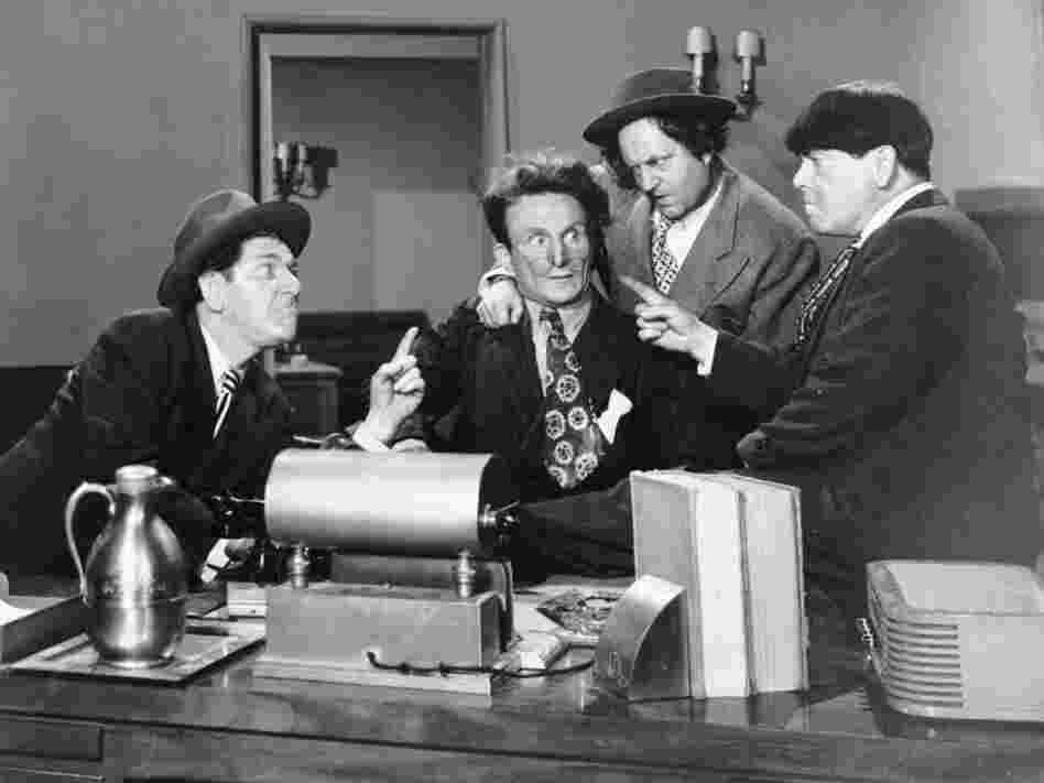 Shemp Howard (at left) is seen in an undated studio handout photo with actor Emil Sitka (second from left) and the other two then-Stooges, Larry Fine and Moe Howard.