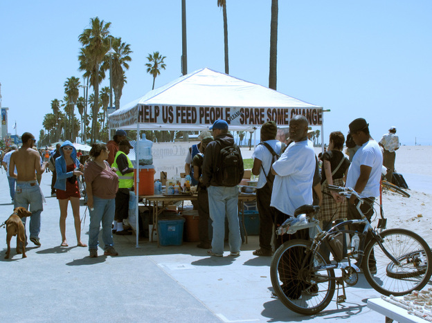 A food tent on Venice Beach, west of Los Angeles, offers a meal to homeless people and others in need. A new project in the area has the goal of reducing the area's homeless military veterans.