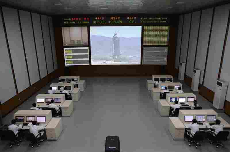 North Korean technicians watch live images of the rocket Unah-3 at the satellite control room of the space center on the outskirts of Pyongyang on Wednesday.
