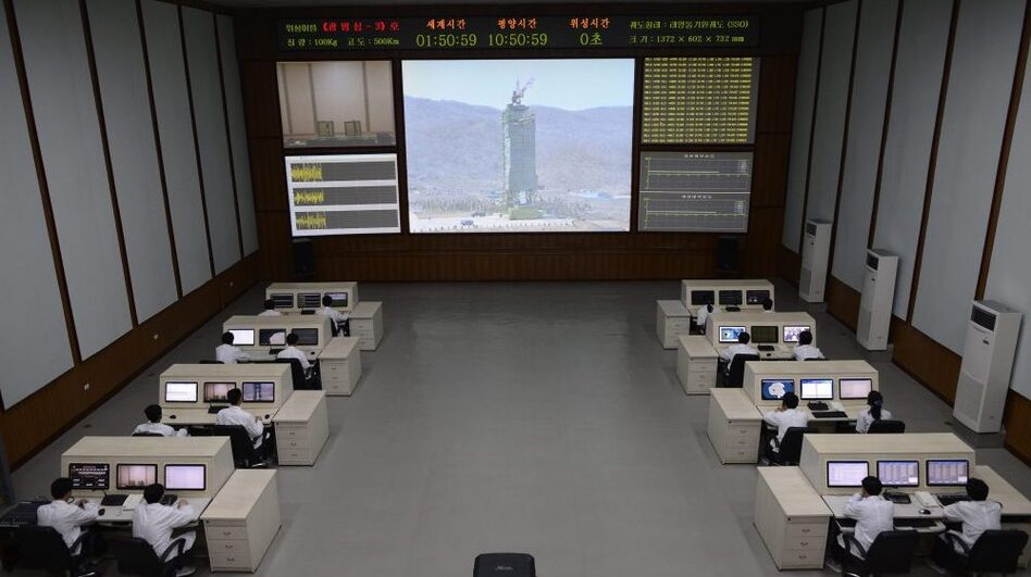 North Korean technicians watch live images of the rocket Unah-3 at the satellite control room of the space center on the outskirts of Pyongyang on Wednesday. (AFP/Getty Images)