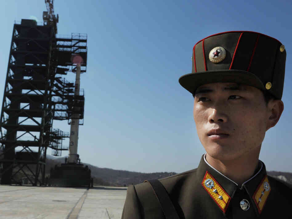 Prior to today's launch, a North Korean soldier stood guard.