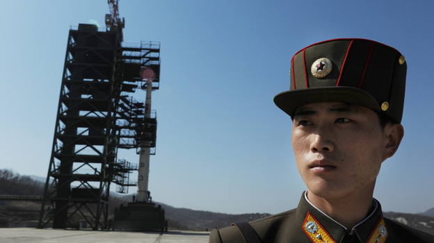 Prior to today's launch, a North Korean soldier stood guard.  (AFP/Getty Images)