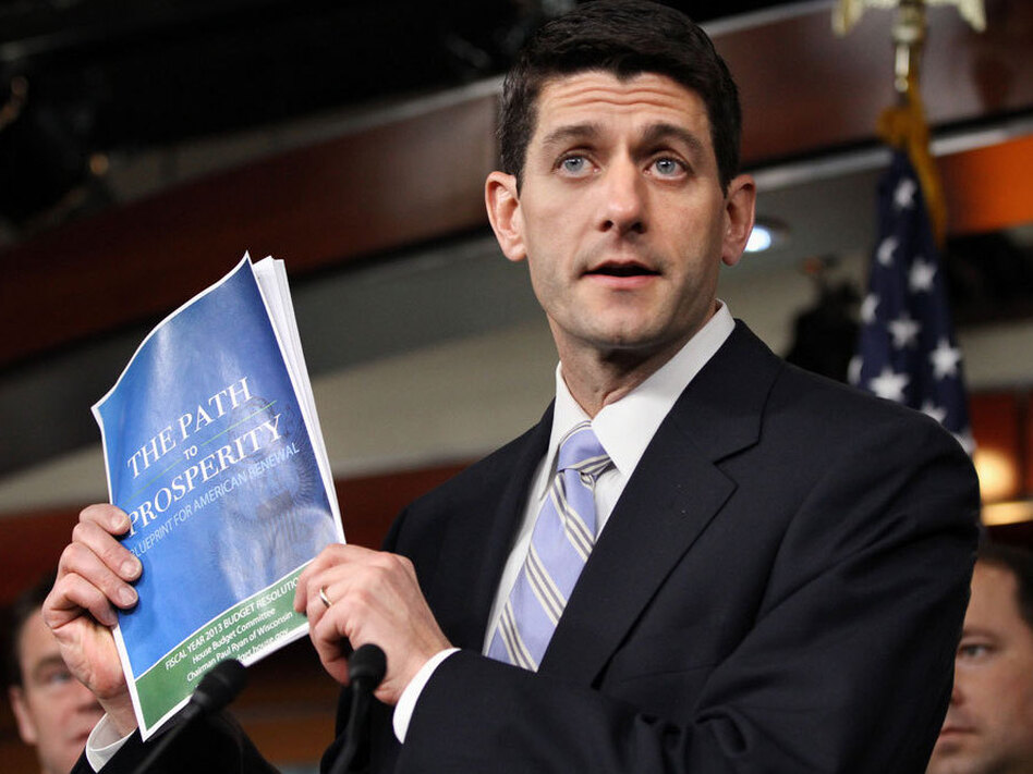 House Budget Committee Chairman Rep. Paul Ryan, R-Wis., with his 2012 budget plan. Ryan cites his Catholic faith in justifying his proposed cuts to social safety-net programs.