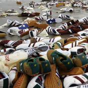 Tennis shoes lay on the beach on Terschelling island, Netherlands, Feb. 10, 2006. They were from a shipping container that fell off a ship during a storm.