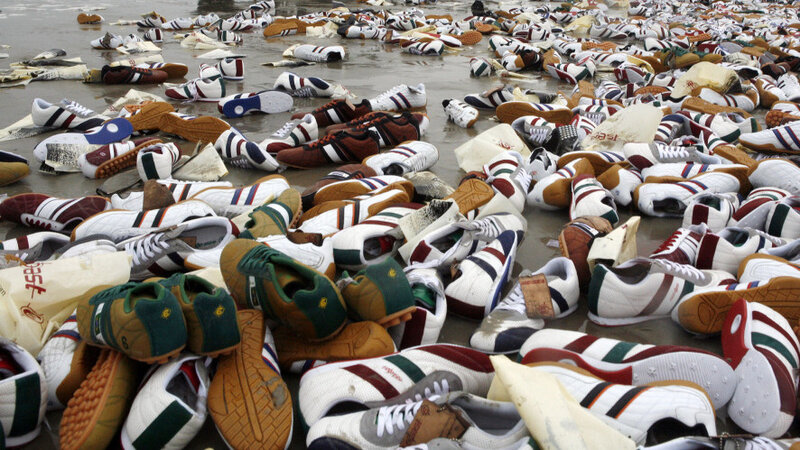 Tennis Shoes Lay On The Beach Terschelling Island Netherlands Feb 10 2006 They Were From A Shipping Container That Fell Off Ship During Storm