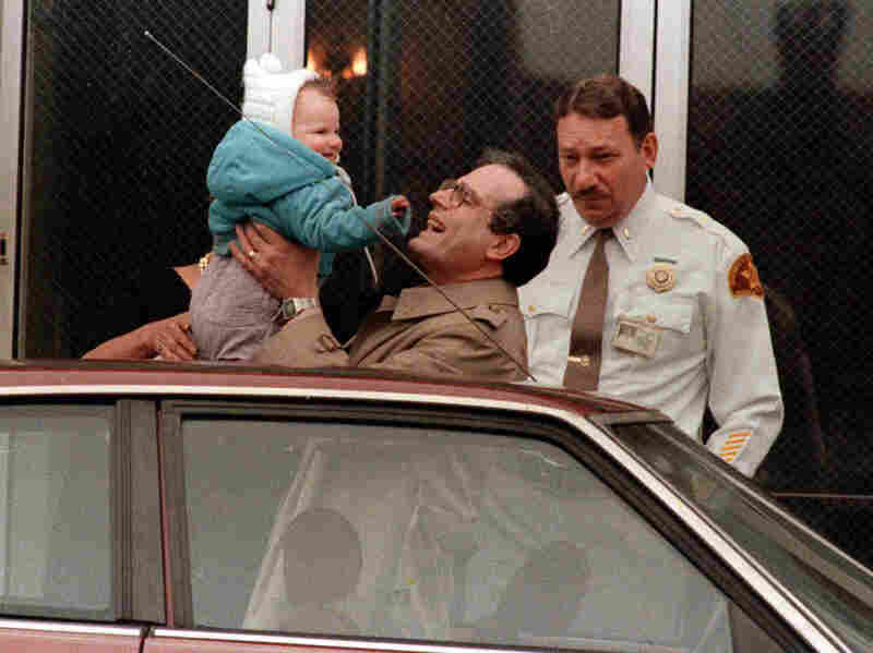 William Stern holds his daughter, then known as Baby M, in 1987. The Sterns' surrogate tried to keep the baby after she was born. Their court battle became the first public debate about surrogacy.