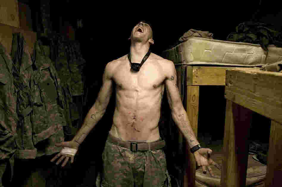 "2007: Spc. Tad Donoho screams after being administered a ""pink belly"" for his birthday: Each member of the platoon strikes his stomach until it begins to bruise."