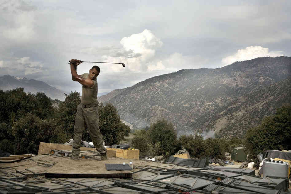 April 2008: Sterling Jones practices his golf swing. Soldiers spend about two weeks at the Restrepo outpost before returning to the main base, where they can get a hot shower and call their families. The outpost was named after 2nd Platoon medic Juan Restrepo, who was killed by insurgents.