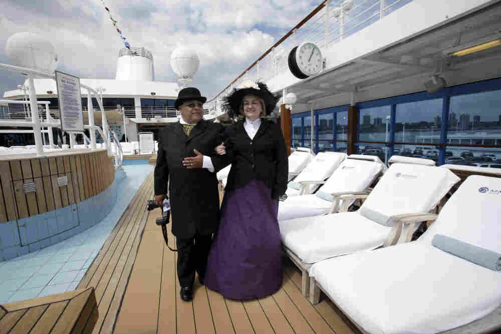 Laurie and Dan Castaneda from Long Beach, Calif., walk the pool deck of the Azamara Journey on a Titanic Memorial Cruise. Preparation for their costumes involved several weeks of research, last-minute purchases and even home-sewn clothing from vintage patterns.