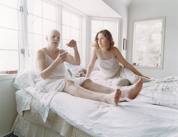 """Annabel Clark, right, with her cancer-stricken mother Lynn Redgrave in March 2003. In her book, Clark writes, """"After shaving my mother's head and feeling that our roles had been reversed, I realized that my project was not just a documentation of my mother's illness, but of how we were navigating it together. It seemed important to insert myself into the narrative."""""""