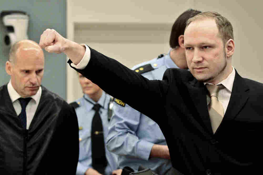 Anders Behring Breivik gestures as he arrives at the courtroom Monday in Oslo, Norway. The terrorism trial against the anti-Muslim fanatic who confessed to killing 77 people starts amid worries that he will use the proceedings to showcase his radical views.