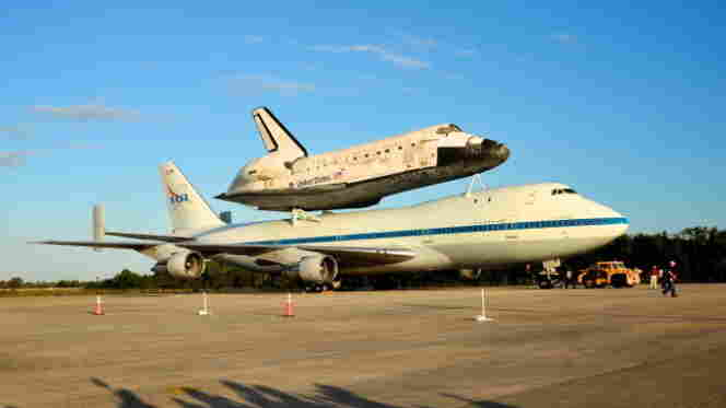 Discovery is sitting atop NASA's 747 Shuttle Carrier Aircraft, which will fly the shuttle from Florida to Virginia.