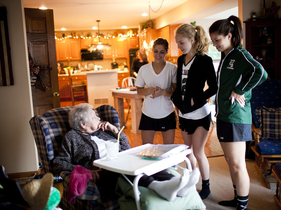 "AnnaBelle Bowers, 87, talks to her granddaughter Carley, 17 (right), and her friends after they returned from lacrosse practice. ""I'm not rich money-wise, but with my family I'm a millionaire,"" Bowers says."