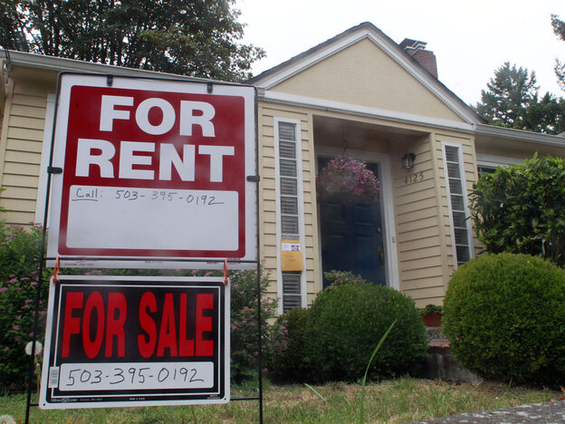This Sept. 13, 2011, photo shows a house for rent and for sale sign in front of a home in Portland, Ore. In our second hour, NPR's Chris Arnold gives an update on the state of housing