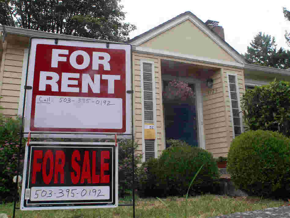 This Sept. 13, 2011, photo shows a house for rent and for sale sign in front of a home in Portland, Ore. In our second hour, NPR's Chris Arnold gives an update on the state of housing markets across the nation.