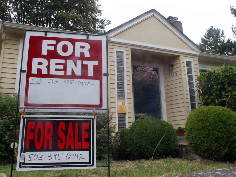 This Sept. 13, 2011, photo shows a house for rent and for sale sign in front of a