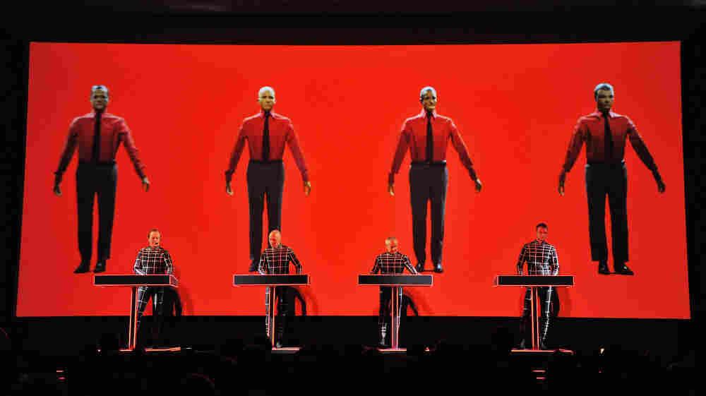 Robots: Ralf Hutter, Henning Schmitz, Fritz Hilpert, and Stefan Pfaffe of the band Kraftwerk perform during the Kraftwerk — Retrospective 1 2 3 4 5 6 7 8 at The Museum of Modern Art on April 10, 2012 in New York City.