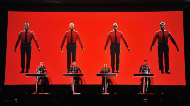 Robots: Ralf Hutter, Henning Schmitz, Fritz Hilpert, and Stefan Pfaffe of the band Kraftwerk perform during the Kraftwerk — Retrospective 1 2 3 4 5 6 7 8 at The Museum of Modern Art on April 10, 2012 in New York City. (Getty Images)