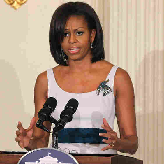 "First lady Michelle Obama says raising her two daughters in the White House ""has been less stressful than I would have imagined."" Seen here at the White House in March, the first lady's new project aims to help military veterans and their families."